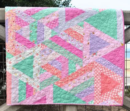 Large triangle quilt design made from jelly roll fabric strips free sewing pattern