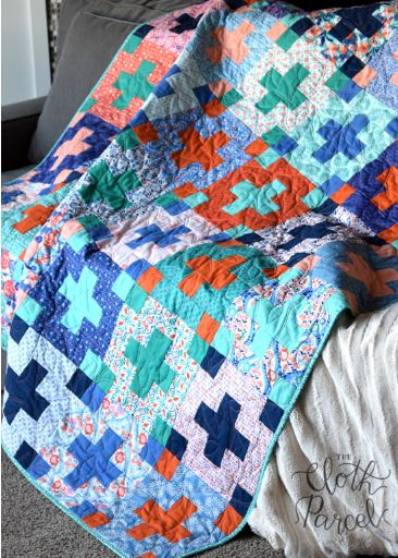 Cross design quilt from jelly roll fabric strips free pattern