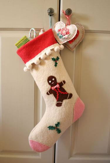 Easy felt Christmas stocking with cuff and pom poms free sewing pattern