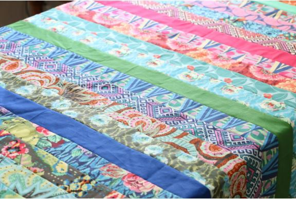 Easy strip quilt from jelly roll fabric free sewing pattern