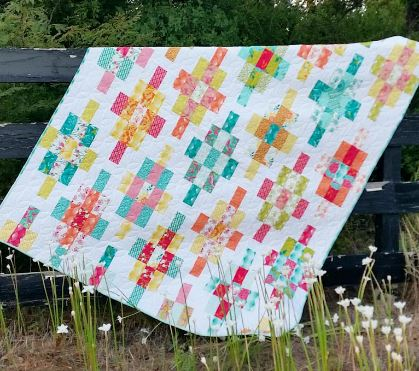 Scrap quilt with square and rectangle design