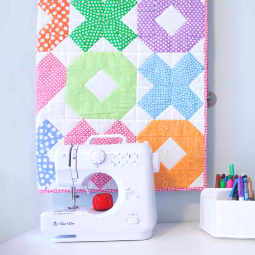Baby quilt with X O hugs and kisses design free pattern