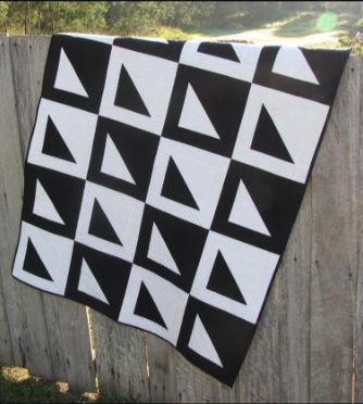 Modern quilt black and white with triangles