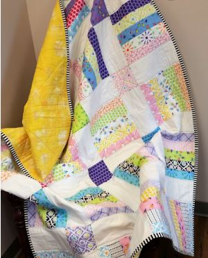 Square patchwork quilt from jelly roll fabric strips free sewing pattern