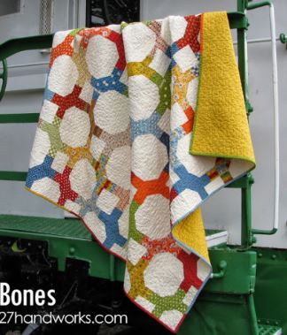 Lattice circle quilt design from jelly roll fabric strips free sewing pattern
