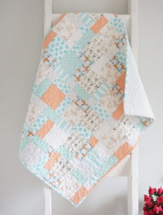 Low contrast baby quilt from charm squares free patterns