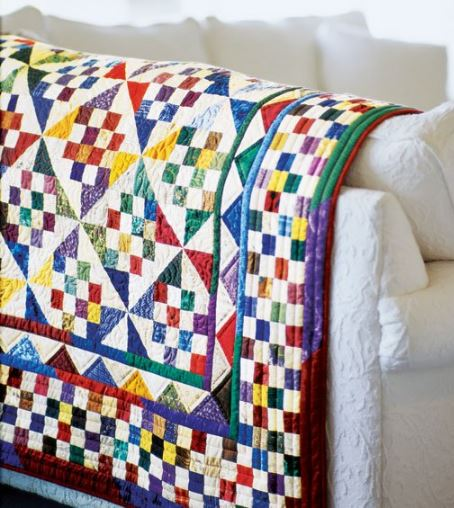 Scrap quilt with small squares and triangles free pattern