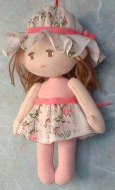 Small girl doll with sad face free sewing pattern