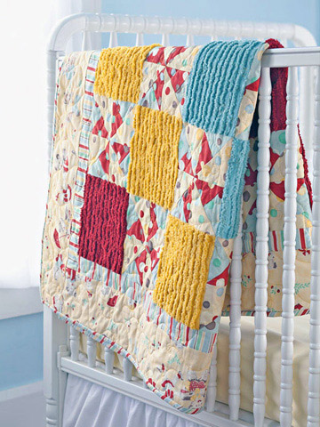 Baby quilt with pinwheel and square design free pattern