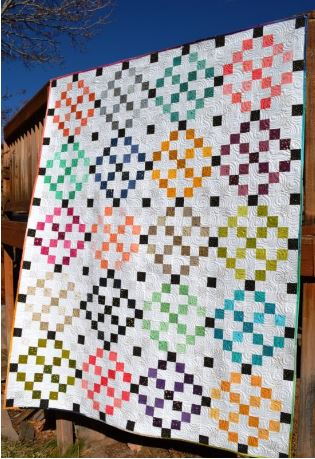 Scrap quilt with square, diamond, and cross design free pattern