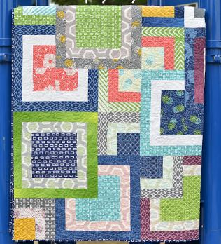 Modern quilt with large squares design from jelly roll fabric strips free sewing pattern