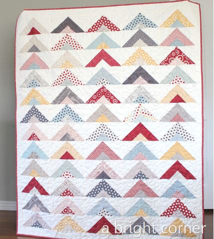 Half triangle quilt design from jelly roll fabric strips free sewing pattern