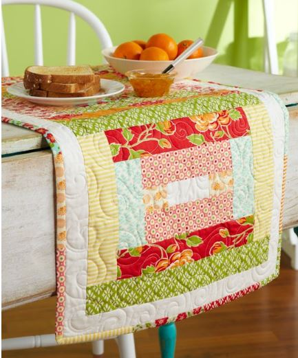 Quilted table runner from jelly roll fabric strips free pattern