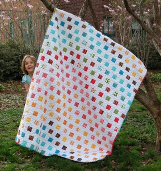 Modern scrappy quilt with small squares free sewing pattern