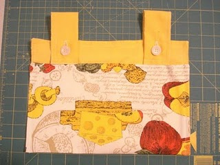 Walker bag with button tabs free sewing pattern