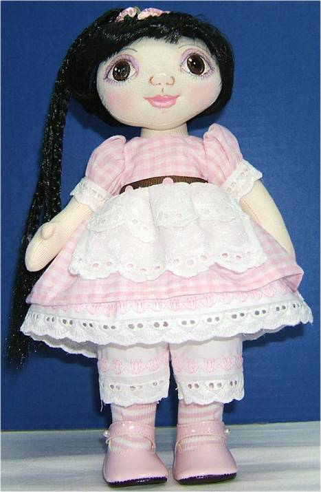 Fabric girl doll with large eyes free sewing pattern